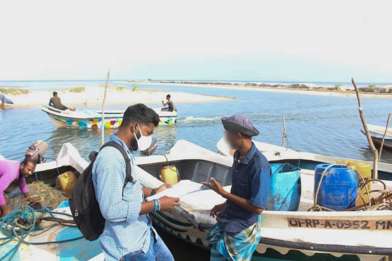 Antony interviews a coastal fisher in Pallikuda